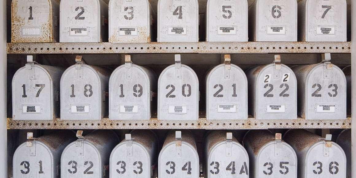 Communal mailbox unit housing 36 metal mailboxes.