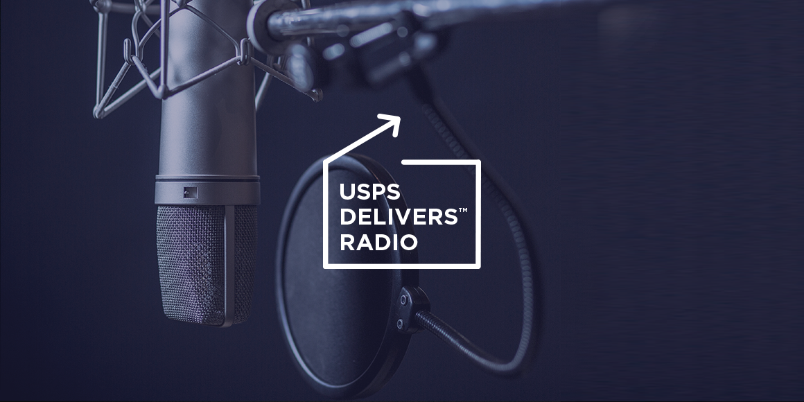 """A professional microphone with the logo for """"USPS Delivers Radio."""""""