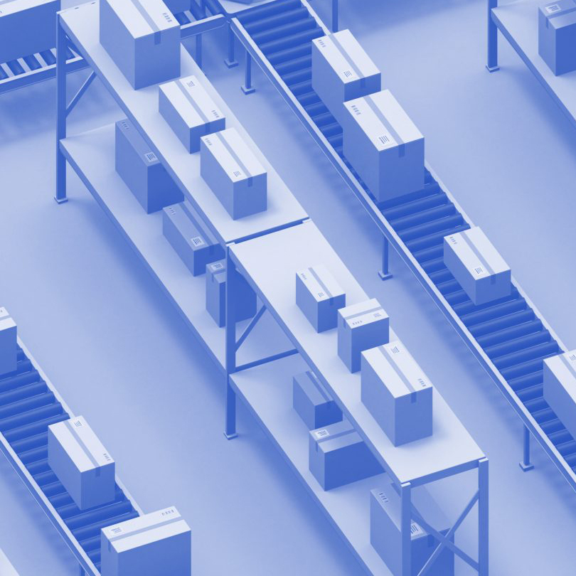 A birds-eye view of a warehouse with boxes on conveyor belts.