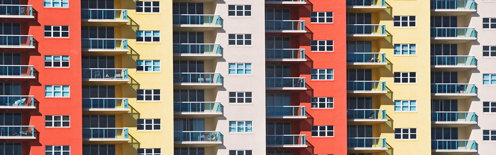 A multicolor apartment building with outdoor decks.