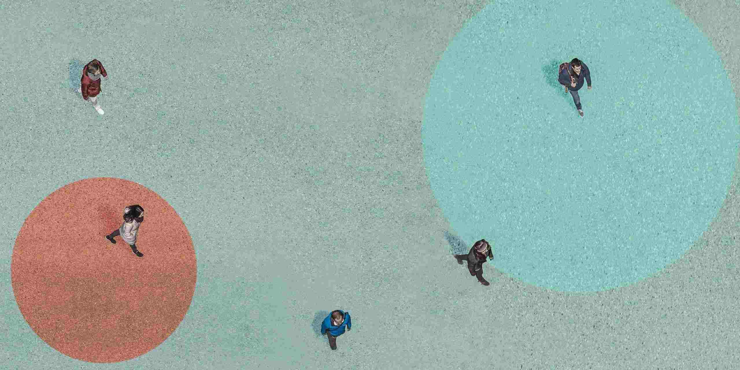 An aerial view of five people walking.