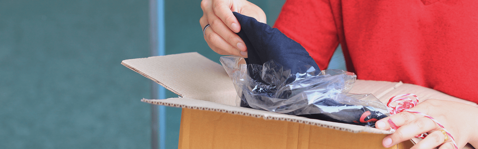 Person pulling a product out of a package.