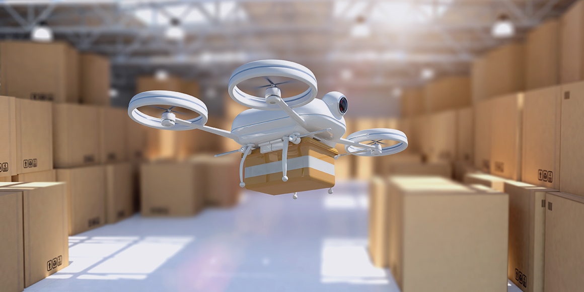 A drone carrying a package in a warehouse.