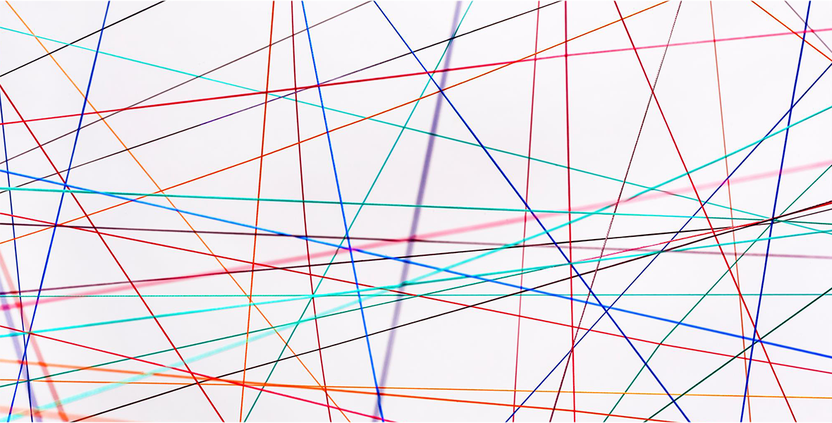 Colorful, intersecting lines representing the interconnectivity of the physical internet.